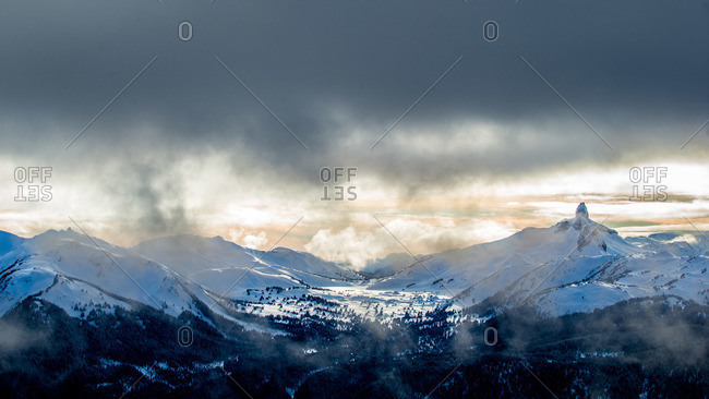 Clouds over snowy mountains