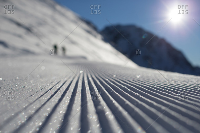 Pattern in snow made by plow on a ski slope