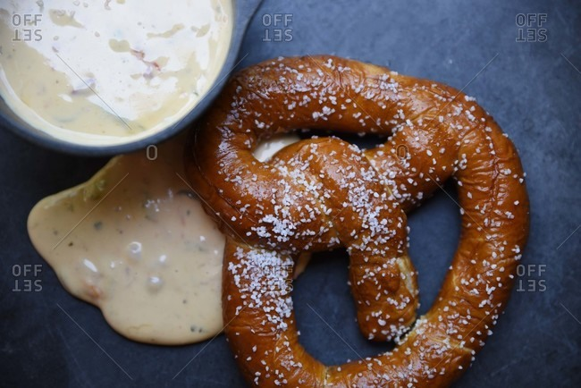 Close-up of a hot pretzel and dipping sauce
