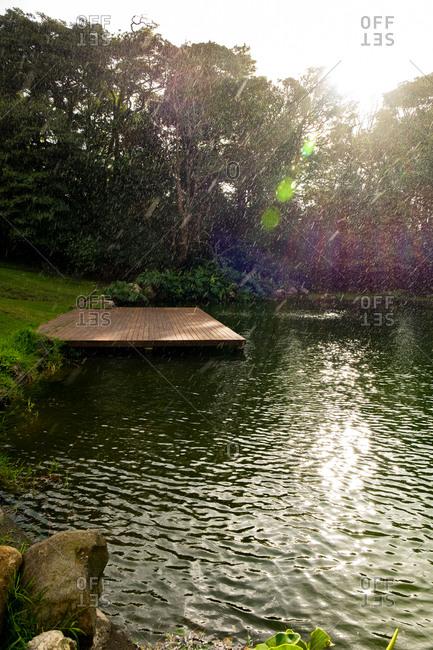 Rain falling over a lake in Costa Rica