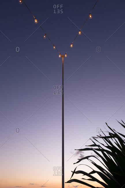 Lights strung from a pole in Coast Rica