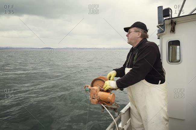 Fisherman reeling in a fishing line
