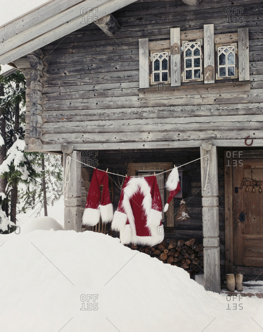 Santa Claus clothes hanging outside cabin