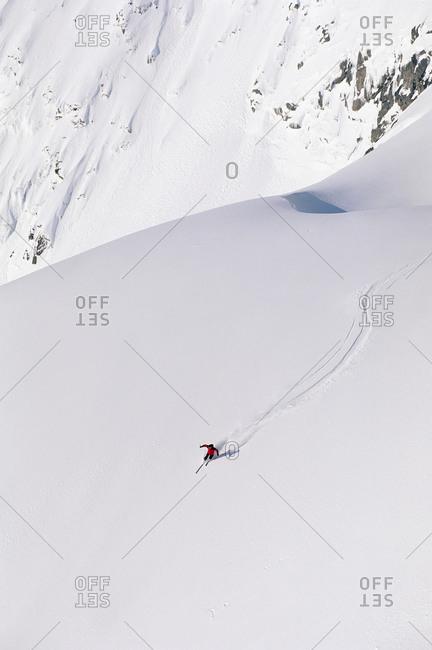 Person skiing down Scandinavian mountain