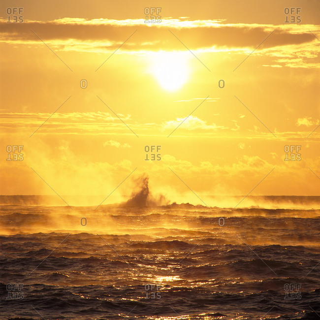 Sunset over the ocean waves
