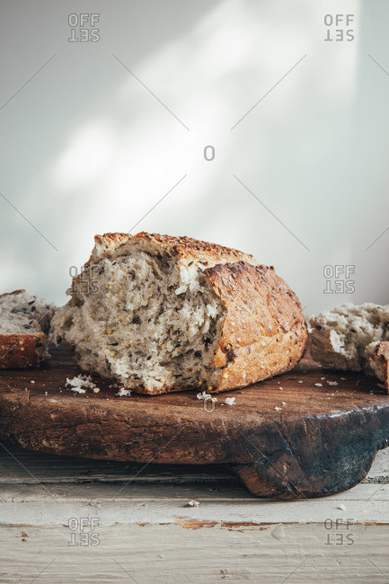 Close-up of crusty multigrain bread served on wooden board