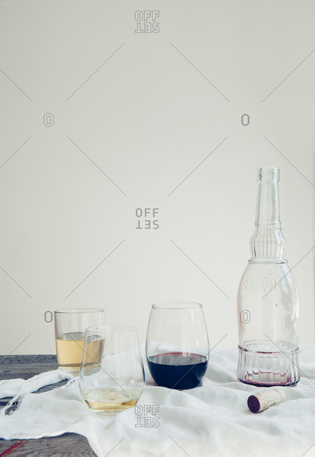 Three different glasses of wine arranged on cloth on wooden table