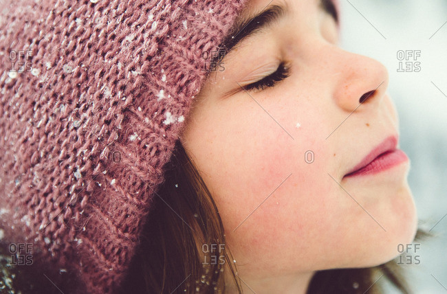 Close up of a girl with pink hat outside in the winter