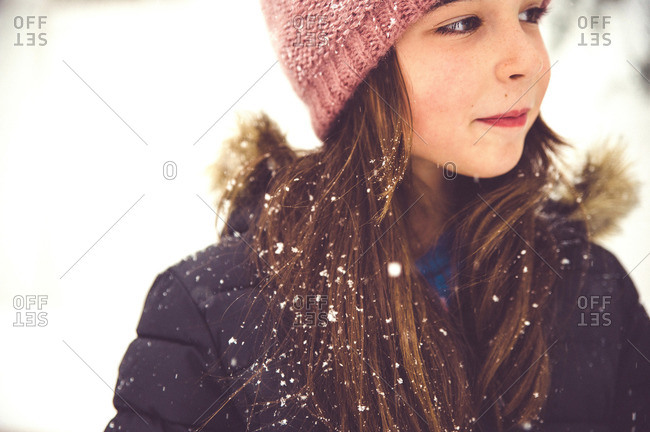Portrait of a girl with pink hat outside in the winter