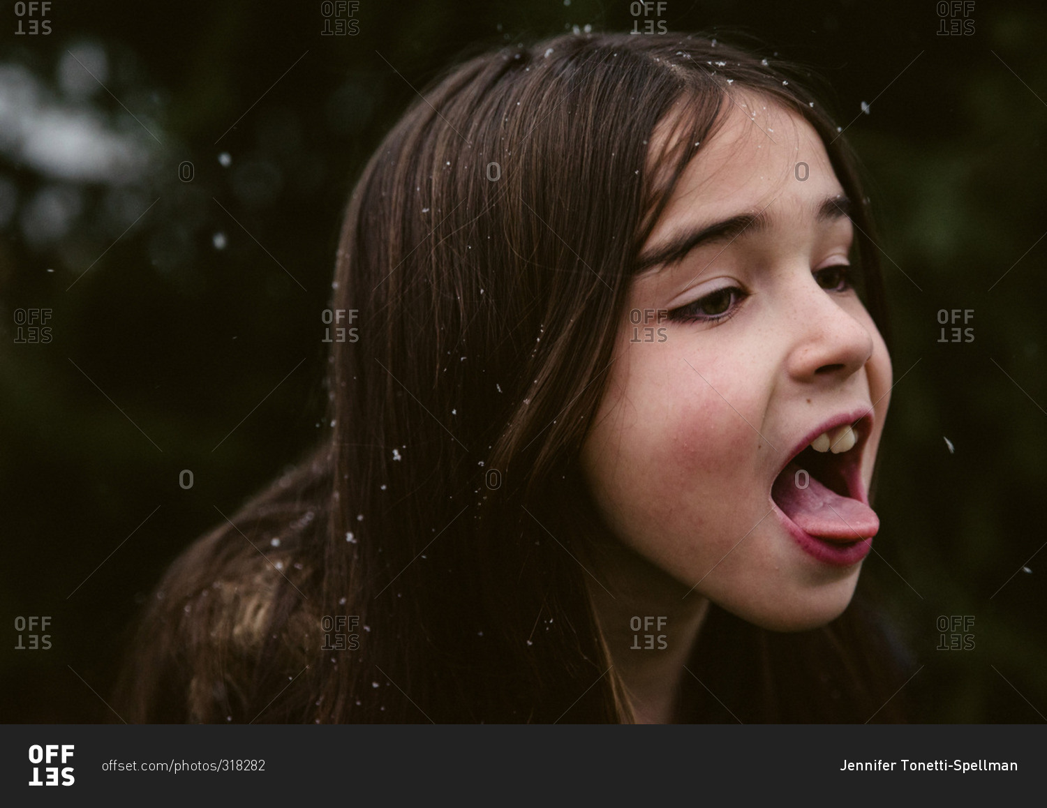 girl tongue Little girl catching snowflakes on her tongue