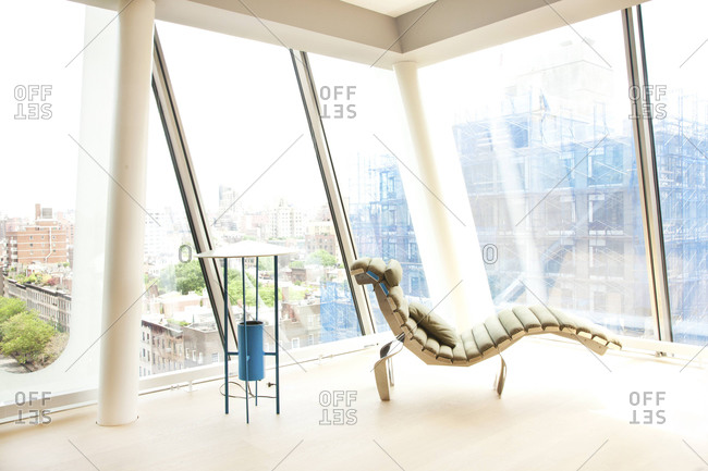 New York, NY - June 13, 2011: Chaise by windows of a condo in the HL23 Building in West Chelsea, New York City