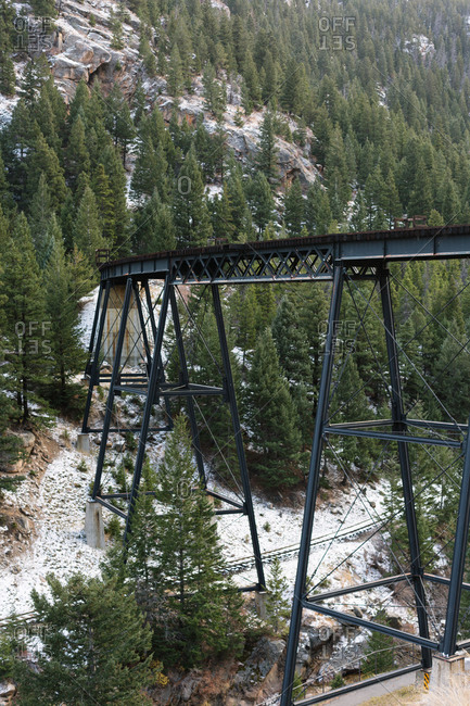 Elevated railroad tracks above a forest canyon