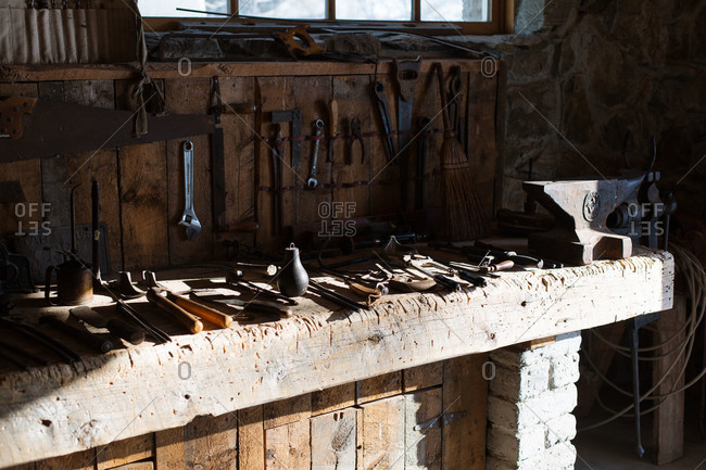 Tools and anvil on workbench in an old tool shed