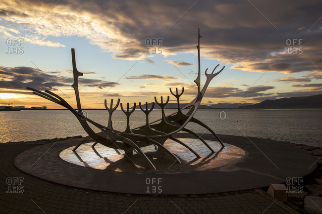 Sunset at the Sun Voyager sculpture of Jon Gunnar Arnason, is made of stainless steel and located on a circle of granite slabs on the waterfront of Reykjavik,  Southwestern Iceland