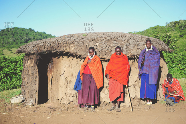 Tanzania - July 15, 2015: A group of Maasai villagers standing together near a shelter