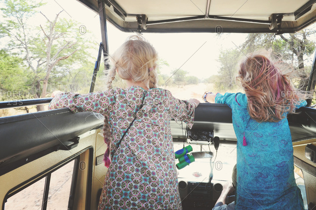 Girls riding through a safari in rural Africa