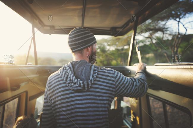 Man on safari tour of the Serengeti