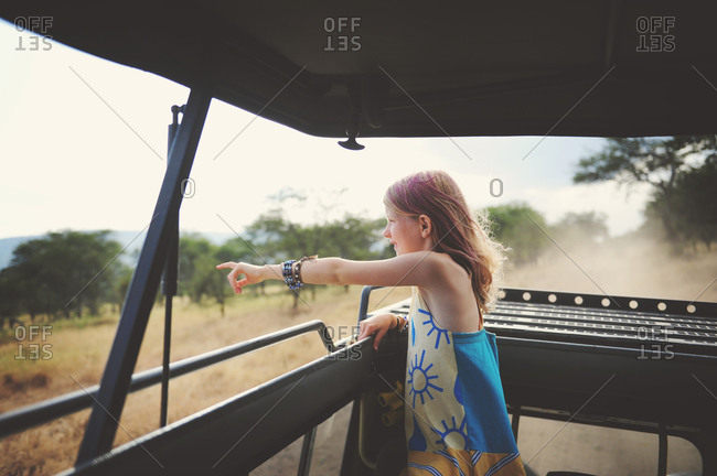 Girl with dyed hair pointing on safari