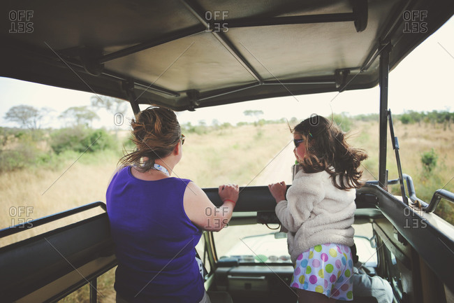 Mother with her daughter on safari in the African Serengeti