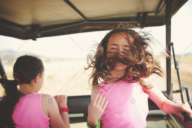 Girl with hair in her face while on safari