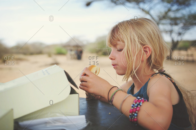 Girl eating at a picnic area in the African Serengeti