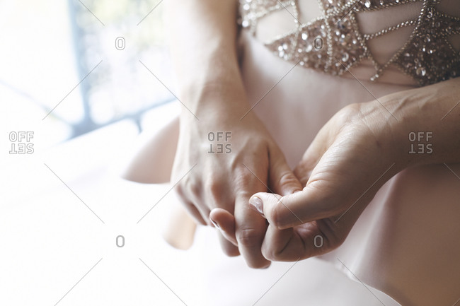 Close up of a bride's hands on her wedding day