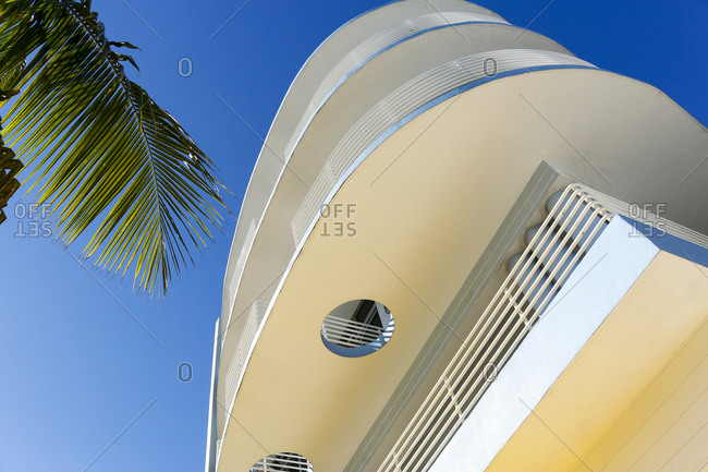 Looking up a curved building exterior in South Beach, FL