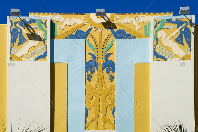Colorful design with birds and naked women on a building in South Beach, FL