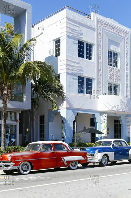 South Beach, FL - January 24, 2016: Classic cars on a street in South Beach, FL