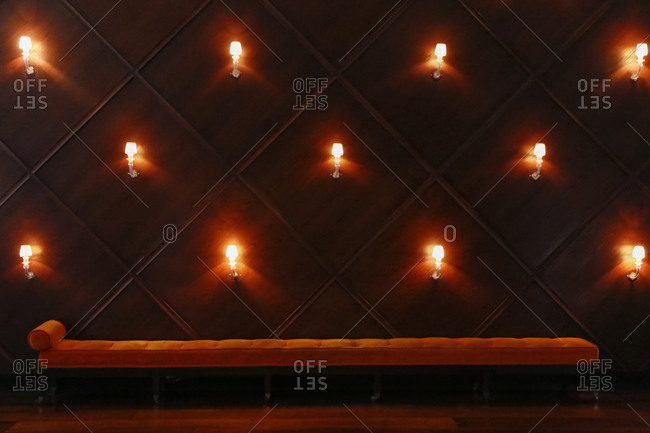 Wall filled with illuminated wall sconces