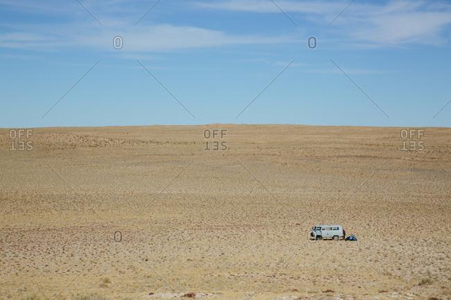 Van dwarfed by the expanse of the Gobi Desert