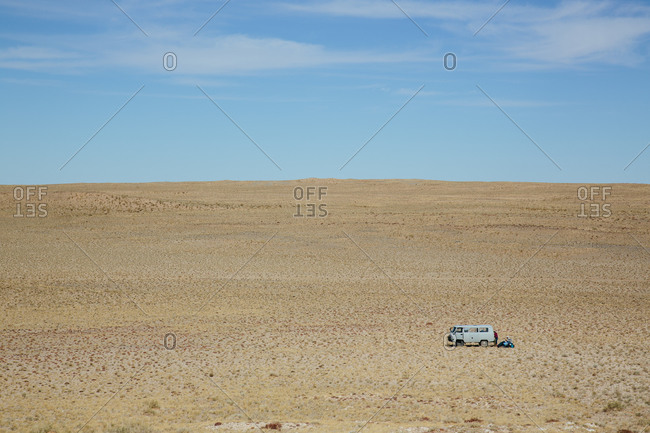 Van dwarfed by the expanse of the Gobi Desert
