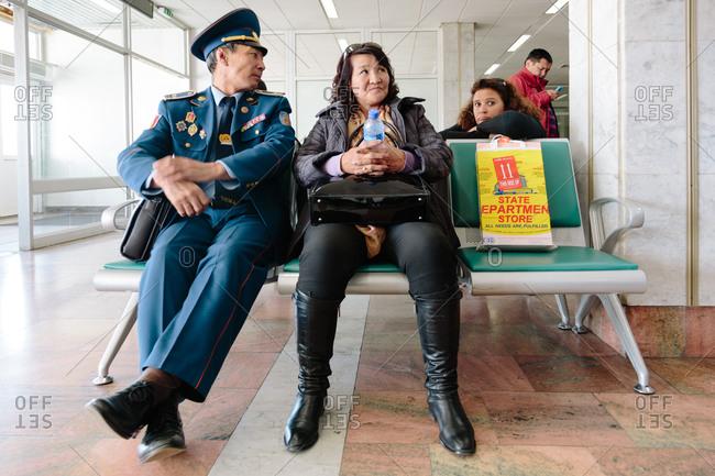 Ulaanbaatar, Mongolia - October 2, 2013: Passengers of the Chinggis Khaan Airport Departure Lounge, Mongolia