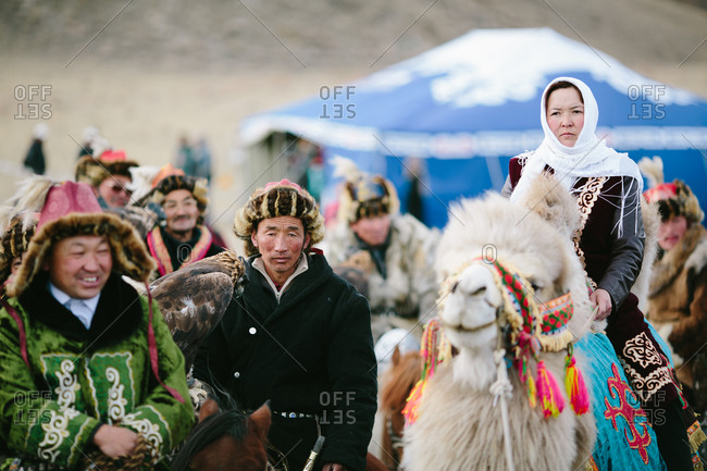 Bayan-Olgii, Mongolia - October 5, 2013: Eagle Hunters and people in traditional clothing gather for the start of the Eagle Festival