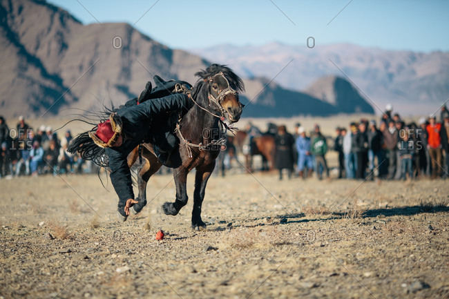 Bayan-Olgii, Mongolia - October 5, 2013: Riders participate in games during the Eagle Festival