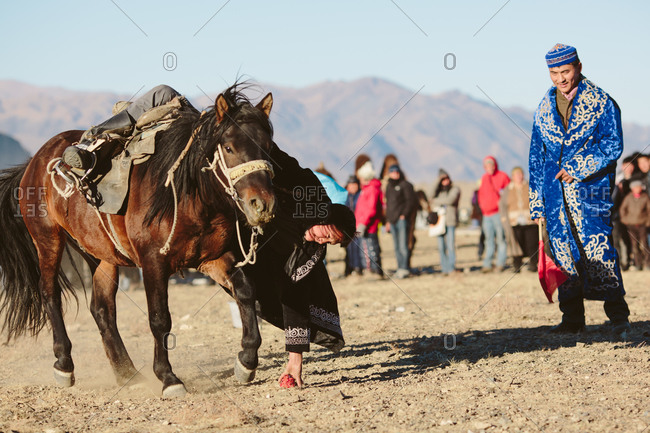 Bayan-Olgii, Mongolia - October 5, 2013: Official watches a rider participate in a game at the Eagle Festival