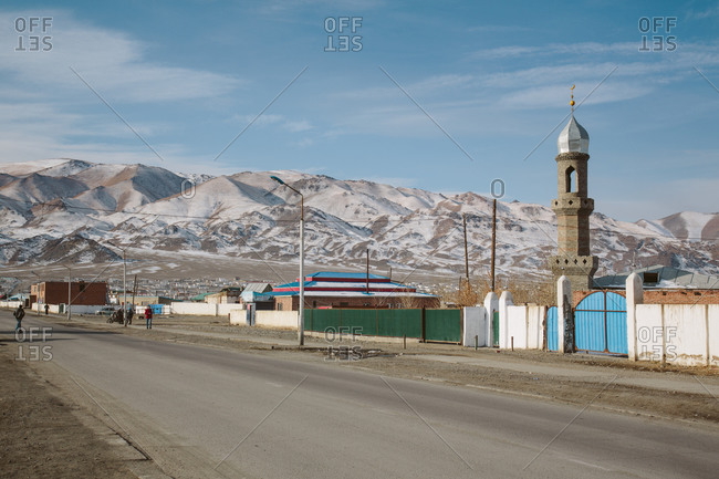 A view of the snow covered Altai Mountains and one of city's mosques