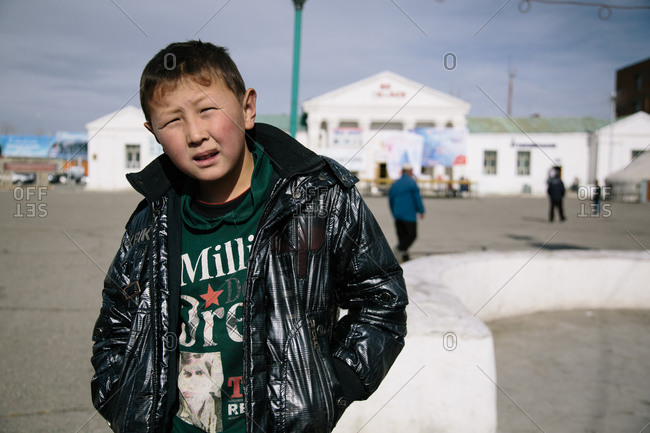Olgii, Mongolia - October 15, 2013: Portrait of a young boy on the streets