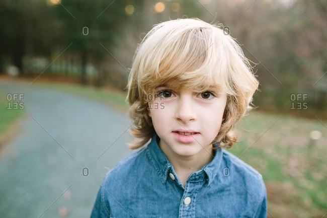 Blonde boy in denim shirt