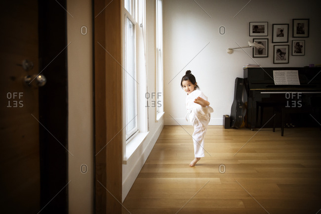 Girl doing martial arts kick