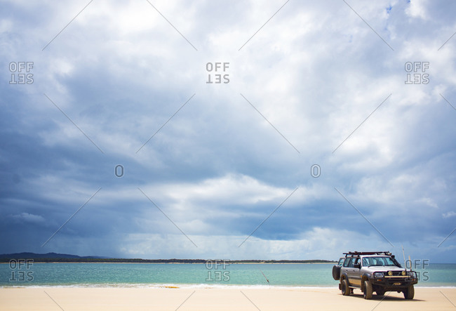 Queensland, Australia - September 12, 2015: SUV on a beach