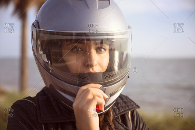 Portrait of woman in motorcycle helmet