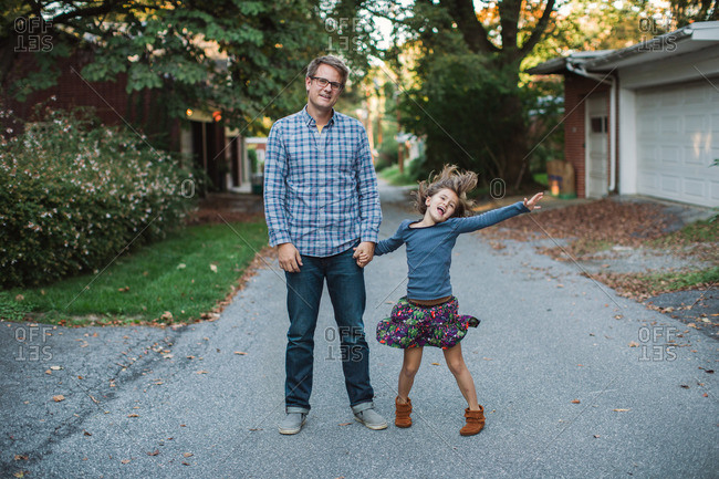 Portrait of a father and daughter standing in the street