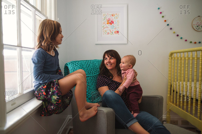 Mother and daughters in a nursery at home