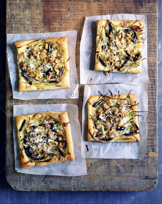 Four square vegetable pizzas