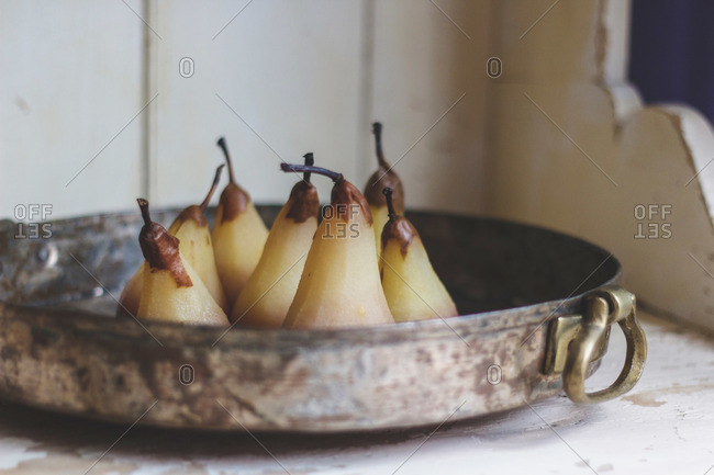 Juice soaked pears in cast iron pan