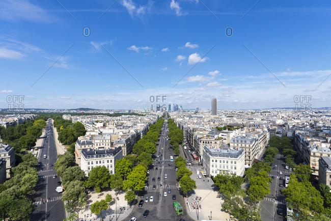 View of three streets and residential buildings in Paris neighborhood