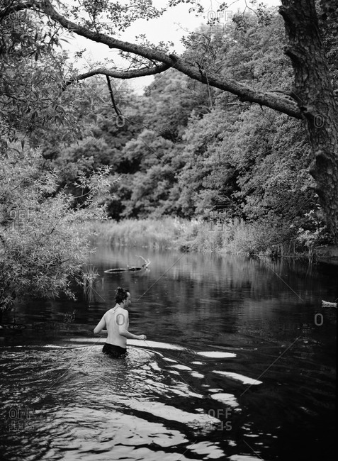 Man having bath in lake