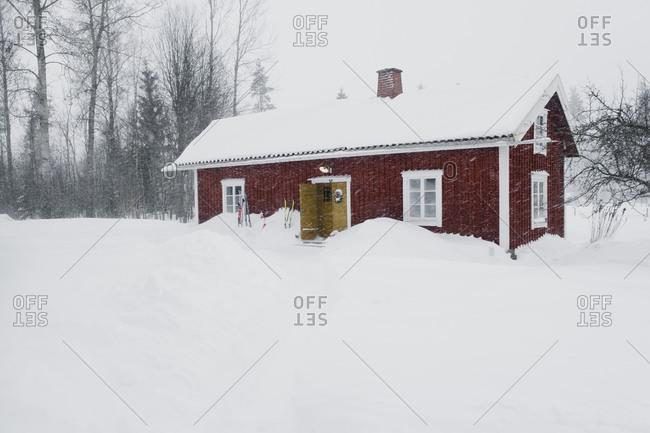 Cottage on snow covered landscape