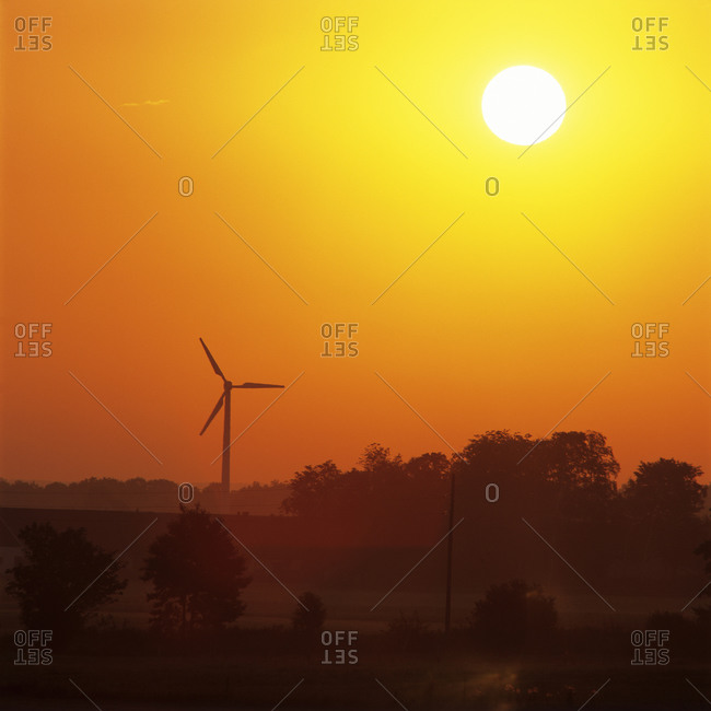 View of single wind turbine at dusk